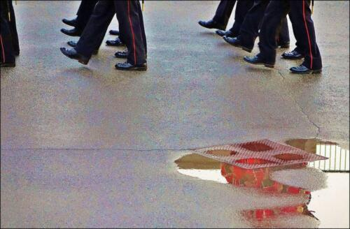 Fort Henry  19.5  Pictorial  Gold  James  Hamilton  The maker chose a shutter speed that was slow enough to show a little motion blur, which in this case is somewhat distracting.  The inclusion of the puddle with a reflection adds interest, but is too far away from the marching soldiers to be effective.